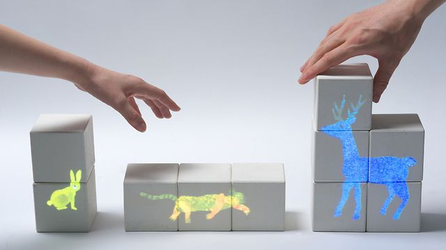 """Interactive Toy Series """"TSUMIKI"""" 〜English Version〜 by PPP. PPP introduces a new way to play with toy blocks. Various images would be projected to the toy blocks depending on how you stack and place them by using image recognition and projection mapping."""