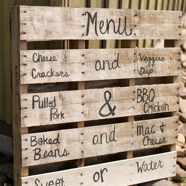 The menu was painted on a rustic wooden pallet.