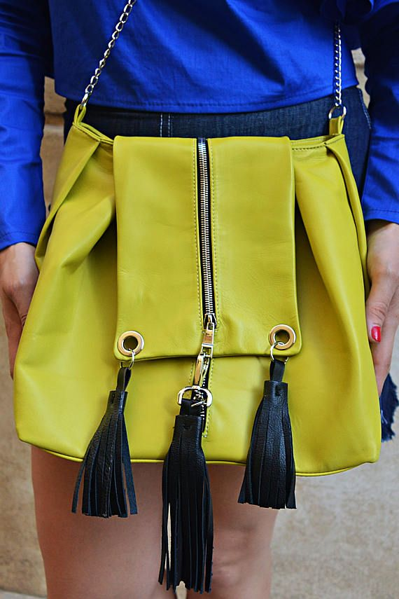 Lemon yellow genuine leather bag with funky black fringes. Practical, light and easy to wear, this bag is a must-have! Goes with absolutely everything and it can carry all your important things! Add a touch of the Andalusian air with this lemon yellow exotic leather bag!  Material: 100% genuine leather
