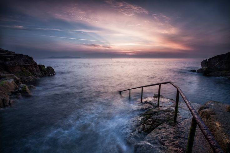 The Forty Foot is on the southern tip of Dublin Bay at Sandycove, County Dublin. People have been swimming here in the Irish Sea all year round for some 250 years. My grandad use to swim here every day of the year like many others.  This image of the popular swimming spot was captured during a beautiful summer sunrise.    Bryan Hanna Irish Landscape Photography