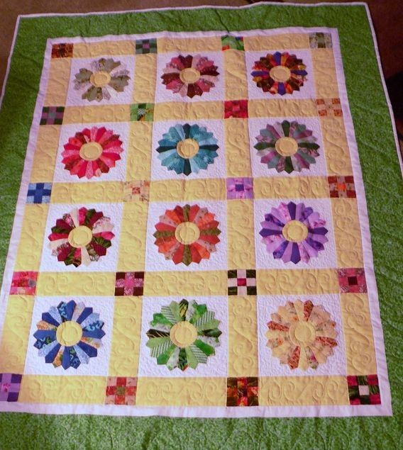 A Picture Of A Beautiful Dresden Quilt With Yellow Borders