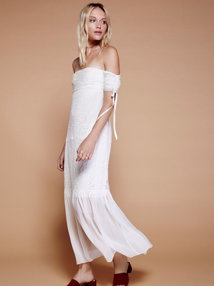 Arlene Maxi Dress | Romantic maxi dress with a beautiful, delicate feel. Features a mermaid silhouette and a femme off-the-shoulder neckline with tie accents at the sleeve cuffs. Crinkly design at the bust with a sheer detail at the hem. Hidden back zipper closure. Lined.