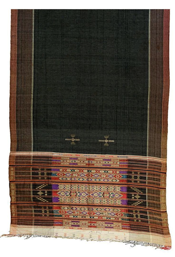 Africa | Ceremonial Asymmetric shawl from Djerba, Tunisia | Cotton; a central panel of white squares on a black background with densely woven borders, the lower part richly embroidered with horizontal bands of abstract decorations worked in metal threads and with fringing