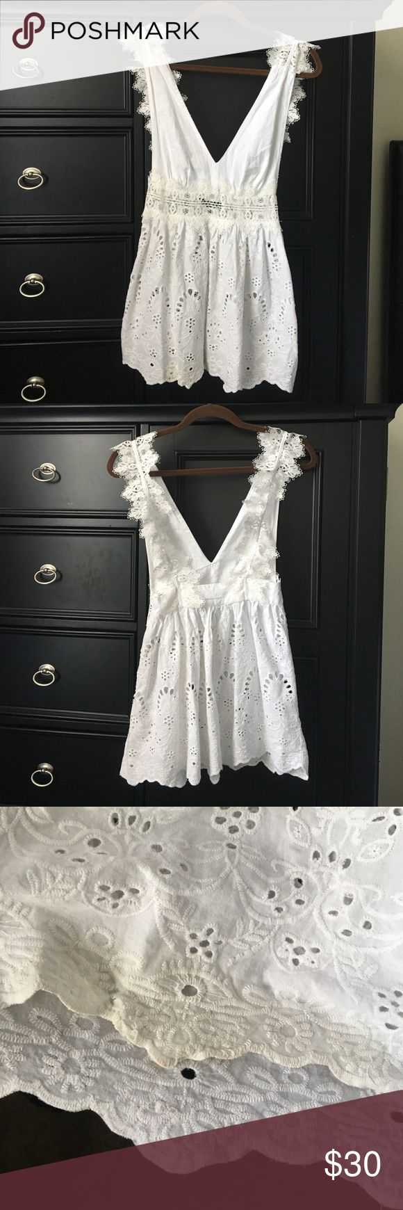 Kendall & Kylie Dress White Embroidered Lace Dress. NEVER WORN AND NWT. I didn't realize there is a stain or discoloration on the end of the dress when I bought it. There is also a little tear where the stain is. Please look at photos for reference. Kendall & Kylie Dresses