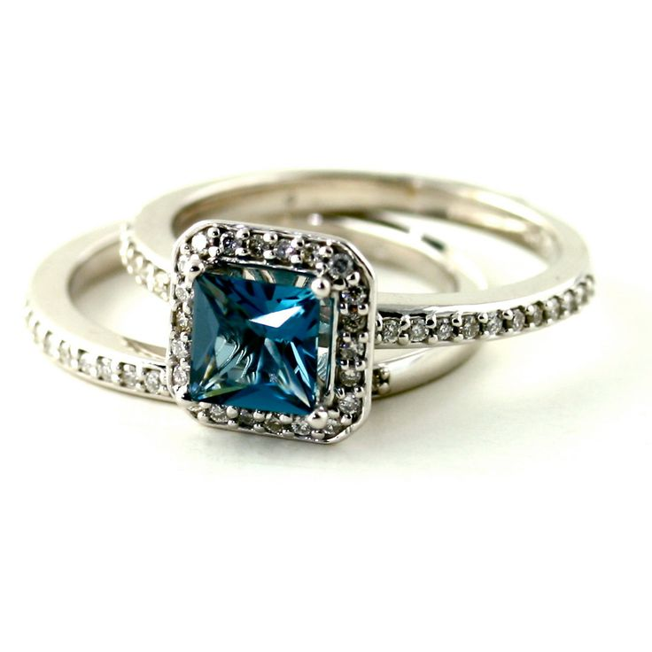 The engagement ring has a 1.10ct Princess cut natural London Blue Topaz at the center, with 44 natural diamonds surrounding it in a beautiful halo and continuing down the ring shank. Gorgeous! Blue Topaz is the birthstone for December.
