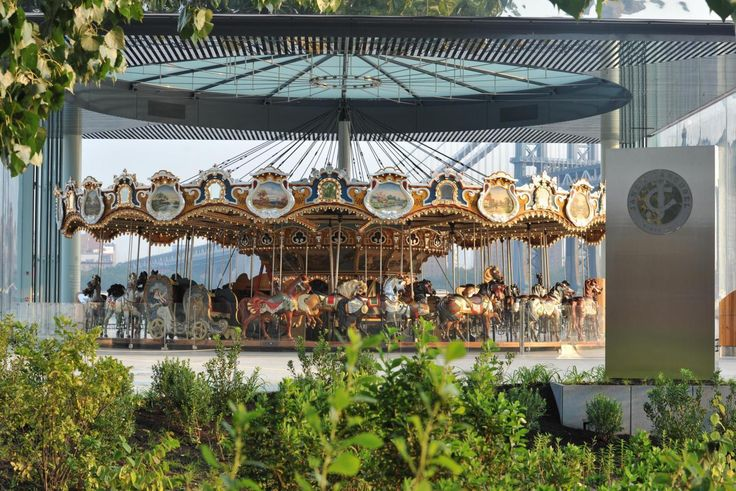 Take a joy ride through history on a beautiful, antique carousel, which was a gift from Jane and David Walentas.