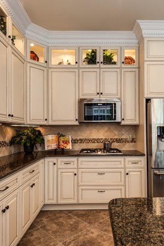 I Like the border and counters with off white cabinets.    Glynmoor Lakes Kitchen - traditional - kitchen - charlotte - Case Remodeling