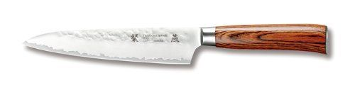 "Tamahagane San Tsubame Wood SNH-1107 - 6 inch, 150mm Utility Knife by Tamahagane. $114.95. 3-Ply stainless steel with VG-5 center and the outside layers of SUS410SS. The angle of the edge is 14 to15-Degree and 61-Degree on the rockwell scale for hardness. The word Tamahagane means ""precious steel"". Dark laminated wood, hand hammered and sandblasted for a matte finish. Manufactured by Kataoka and Company in Niigata, Japan. The Tamahagane San Tsubame hand-ha-mmered kn..."