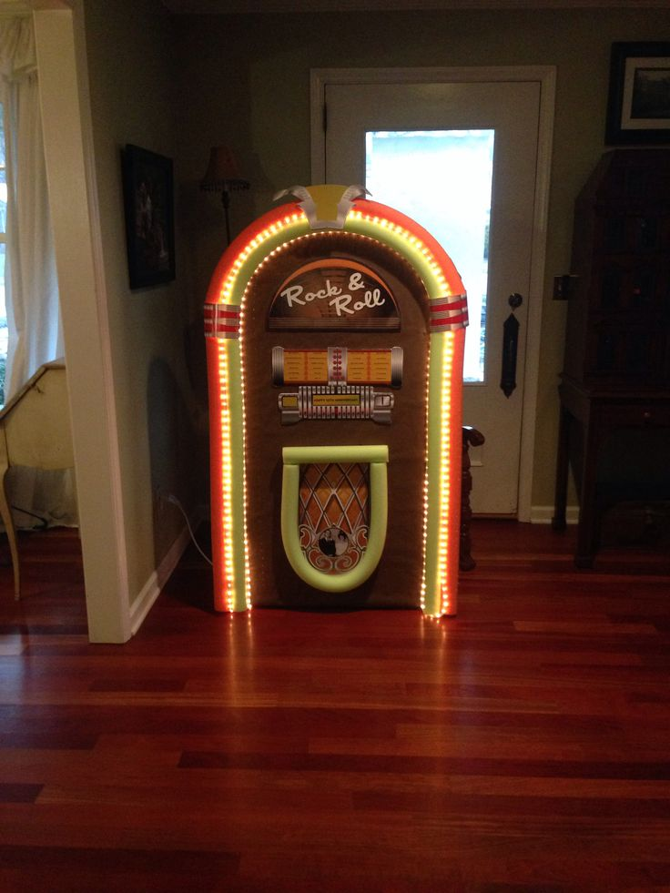 Jukebox I made for parents 50th anniversary sock hop. Made from styrofoam insulation board, pool noodles, graphics I designed and printed at Costco and mouthed to foam core. Finished off with rope lighting from hardware store. Used gorilla glue to glue pool noodles.