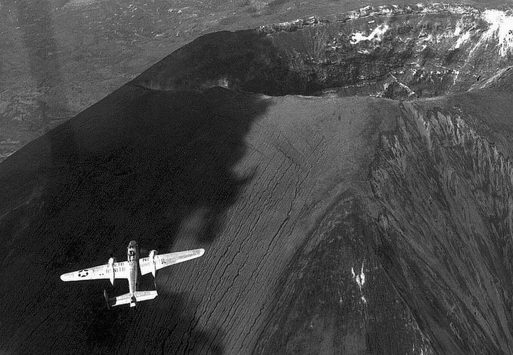 B-25 Mitchell bomber flying over the crater of Mt Vesuvius, Italy, May 1945