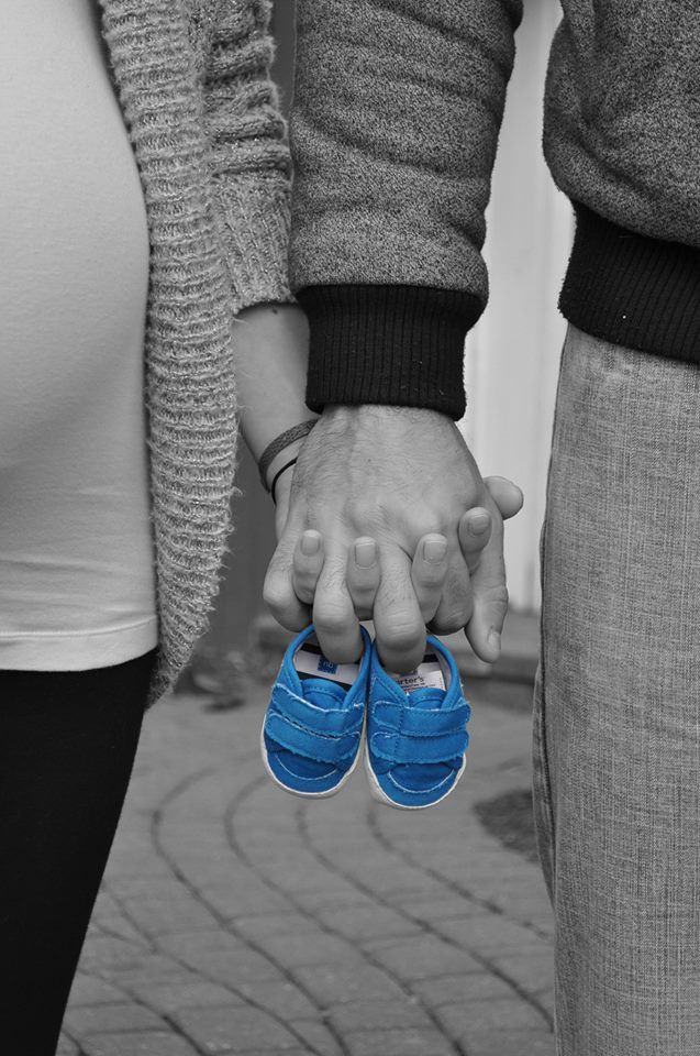 I like this but maybe kind of re-create our engagement pic standing holding hands on a blanket with the shoes in hand.