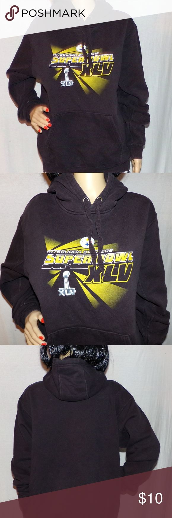 """Pittsburgh Steelers Hoodie Super Bowl XLV 2010 M Pittsburgh Steelers Hoodie Super Bowl XLV 2010 Hoodie NFL Brand M Vintage Find Low & Fast Shipping. NFL Team Apparel Brand and has their label in it. This is in VG Vintage condition 80/20 Cotton Polyblend MEASUREMENTS Size is M (Medium) L-25""""/Across the Chest-22""""/Sleeve-24"""" BUNDLE 2 or more of our items for a FAIRY SPECIAL PRICE or make us a FAIR OFFER the Fairies her Love FAIR OFFERS :) NFL Team Apparel Tops Sweatshirts & Hoodies"""