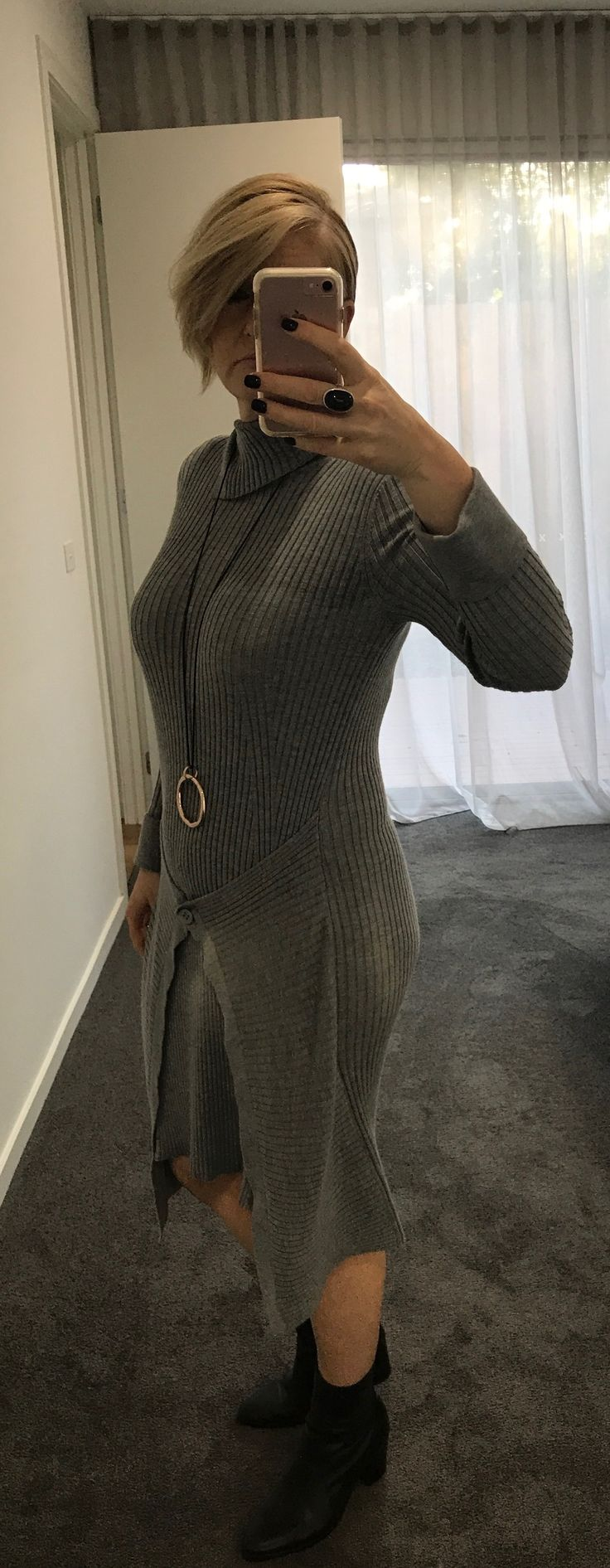 This dress from Willow is over 4 years old.  A great investment that I have in grey and black.  Thrown on with black boots, style made too easy!  A knit dress with a twist is always a winner.