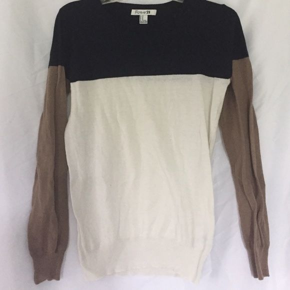 Blue/cream/tan sweater F21 sweater size Medium but this one is more like a small. Polyester, acrylic, nylon, and wool. Hand wash only. Forever 21 Sweaters Crew & Scoop Necks