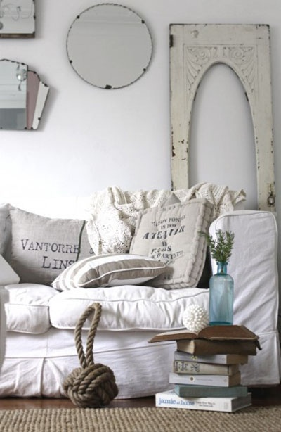 Love the architectural salvage, the mix of mirrors, the whole vignette, and the fact that you could just sink into that gorgeous but comfortable sofa..