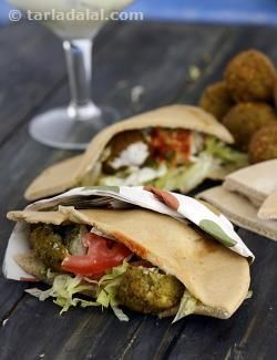 Falafel is an assembled mezze of chick pea patties sandwiched between pita bread. This popular sandwich has found place in most restaurant menus across the globe. The sandwich can be moistened with some of our desi green chutney or either by authentic lebanese garlic sauce.