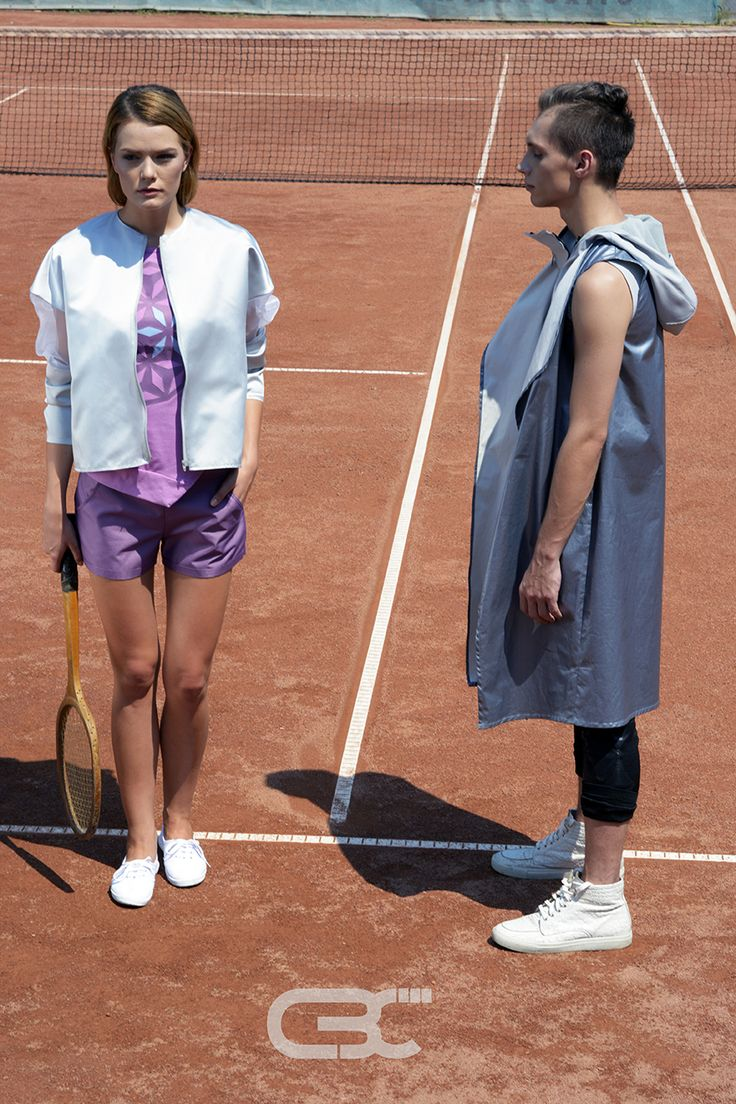 Lookbook: Her: Silver and sheer bomber jacket, pint tshirt, purple shorts Him: Grey Hoodie, blue metallic vest, black pants Tennis court, sport, sportswear, fitness, trends, unisex, campaign photos. Order via facebook, pm or e-mail.