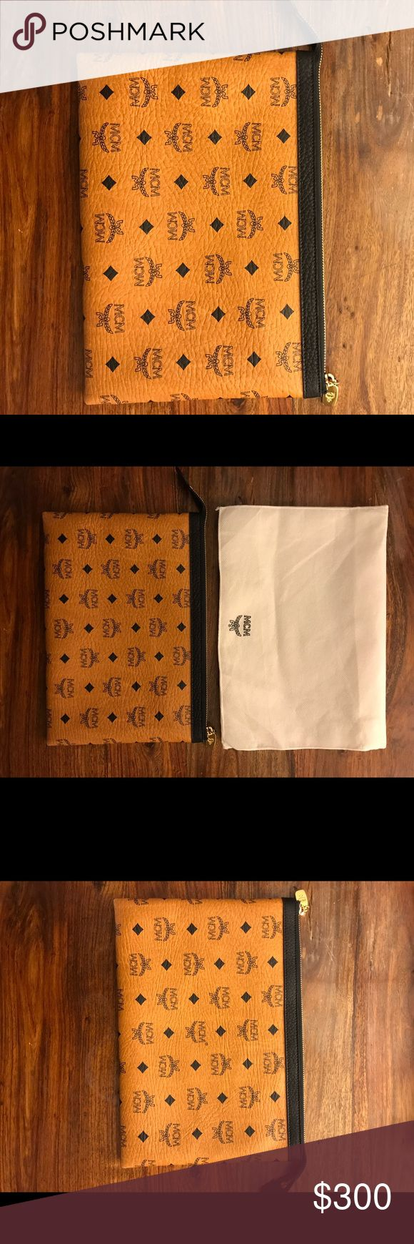 MCM NEW Clutch Only worn once. Black and brown clutch. With dust bag. No signs of wear. Price is firm. No lowball offers please. MCM Bags Clutches & Wristlets