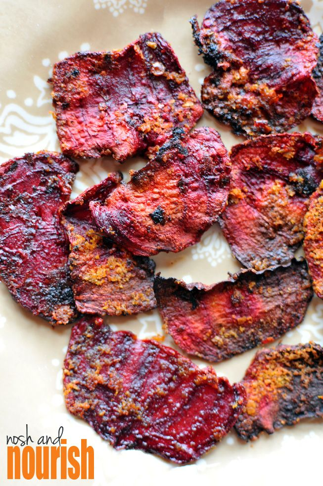 Chili Roasted Beet Chips -- a perfect flavorful  salty snack. (Even my husband who HATES most vegetables and especially beets LOVED these chips!) // via Nosh and Nourish