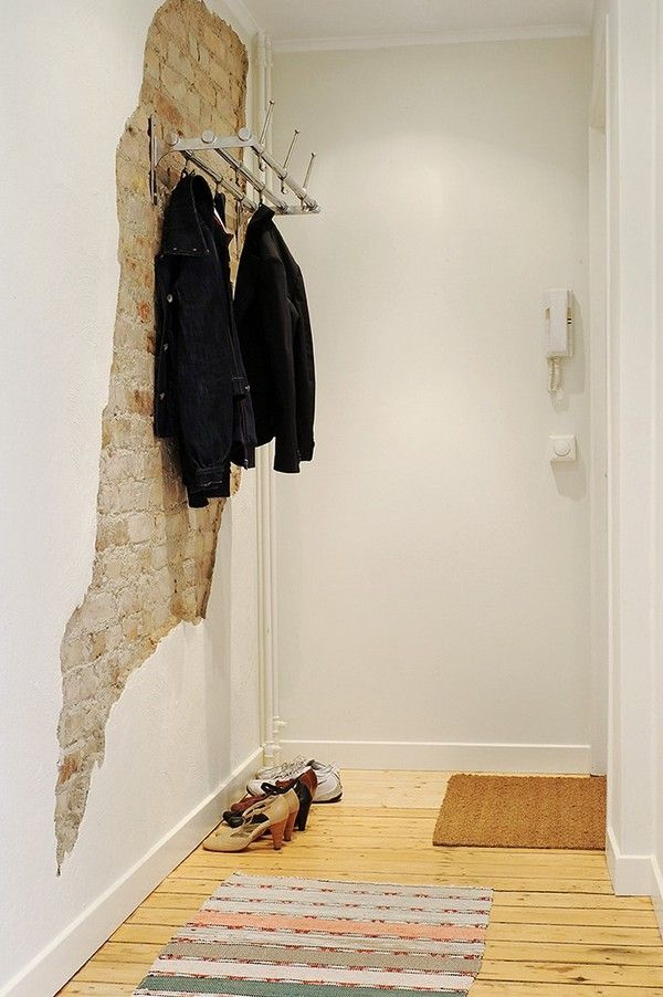 Exposed brick or stone.  Such a cool idea for a foyer.
