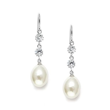 These elegant earrings feature a French wire top with two cubic zirconia stones that flow into a oblong light ivory natural fresh water pearl.  These whimsical earrings glisten with understated elegance.   Height: 4.1 cm x Width: 1 cm