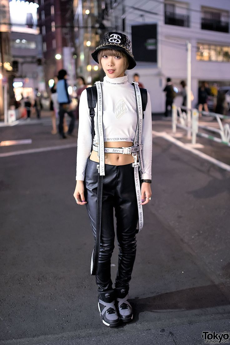 [Monochrome Fashion on Cat Street] Naco is wearing a white harness by the Japanese streetwear brand M.Y.O.B NYC (they have blown up in Tokyo this fall) over a white MYOB turtleneck crop top, faux leather pants from H&M, and Nike sneakers. Accessories include jewelry from Folli Follie, a Stussy quilted bucket hat (with a chain), and a large black backpack. #MYOB #JapaneseFall2014 #Monochrome