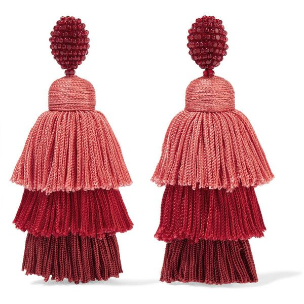A pair of statement earrings can create instant drama. Oscar de la Renta's tasseled design is made from tiers of coral, red and brick threads that gracefully h…