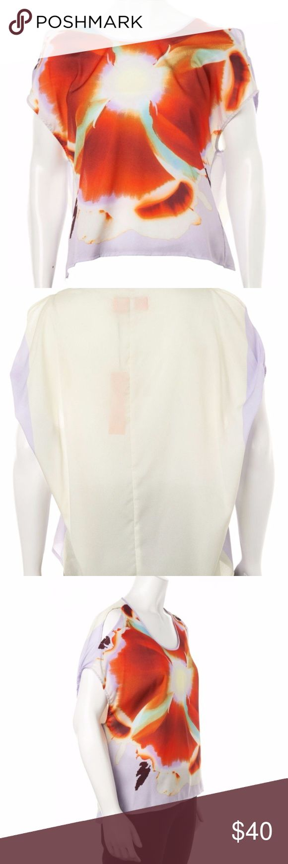 """Clover Canyon Digital print Cold shoulder Top New with tag attached. Lavender cream and orange multicolor digital flower cocoon top by Clover Canyon size XS. Cold shoulder with gathered sleeves, wide scoop neck, and high-low hem. Pictures are  of actual item.  Chest: 42"""" Length: 22"""" Retail Price: $213.00 Condition: Pristine Fabric: 100% Polyester; Combo 100% Polyester Designer: Clover Canyon Clover Canyon Tops"""