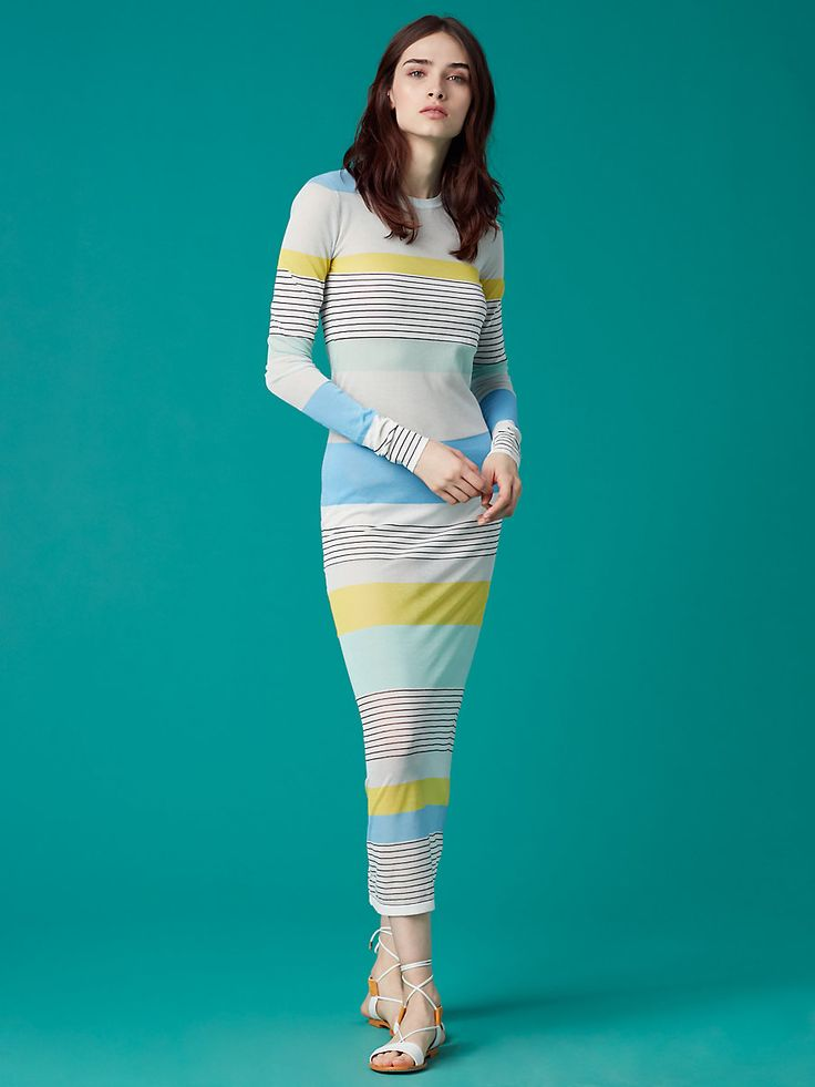 Cut in a lightweight cotton blend in stripes of invigorating summer tones, this gauzy, stretchy, long-sleeve, crew neck midi dress is an endlessly versatile summer staple that looks impeccable worn over a bathing suit or layered over jeans.