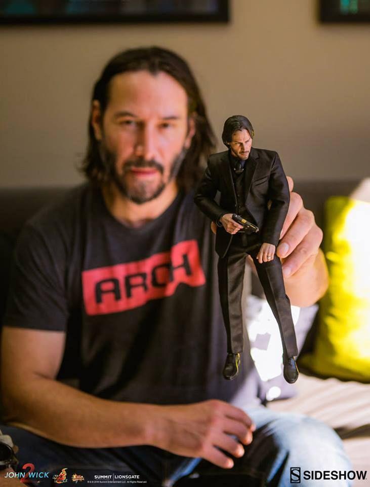 Keanu Reeves And Action Figure Of John Wick Keanu Reeves In 2019