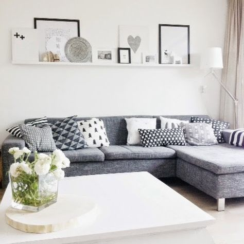 love the narrow shelving above this sofa in this living room, great gallery…