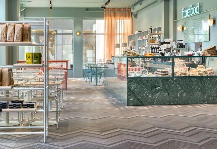 Bar bistrot Finefood – Kärlek & Mat. Pavimento con piastrelle di Mutina, grande bancone di marmo verde proveniente all'India e vetro