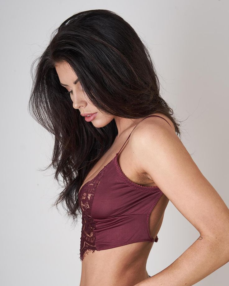 Feminine peek-a-boo lace cutout in the front of this sexy bralette from Lira Clothing available in burgundy or black. Created with 94% polyester, 6% spandex, you really get beauty and comfort in this bralette.