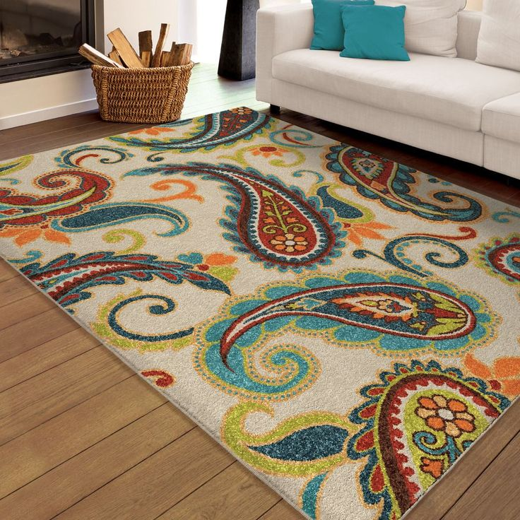 Indoor/Outdoor Paisley Pampano Multi Area Rug is the perfect all-occasion rug. The ivory background holds the dark blue, light blue, brown, lime green, red, orange and yellow paisley design, sure to bring a bright and fresh look to your home!