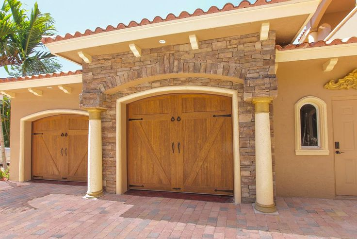 Clopay canyon ridge collection faux wood carriage house for Faux carriage garage door
