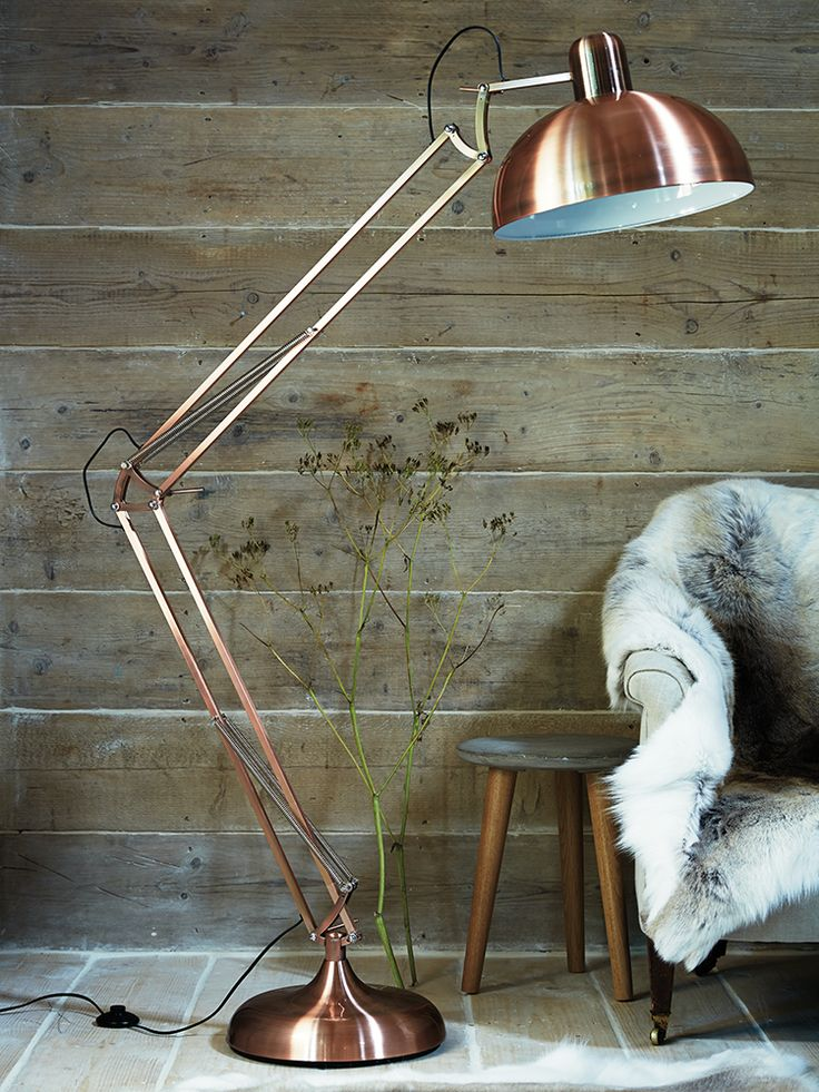 Tore Floor Lamp - Made from iron with a striking copper colour finish, this stylish over-sized angled light creates a statement in any space.
