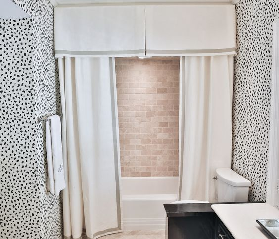 Thibaut Tanzania Wallpaper with great shower curtain and valance to hide traditional bathroom by Amy Berry
