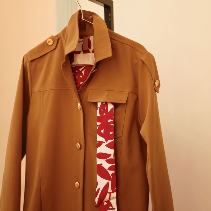 French Style Masculine Inspired Jacket with asymmetric epaulettes, red printed lining and golden buttons. Shop at RAQUETTE Store and online on www.maisonraquette.com