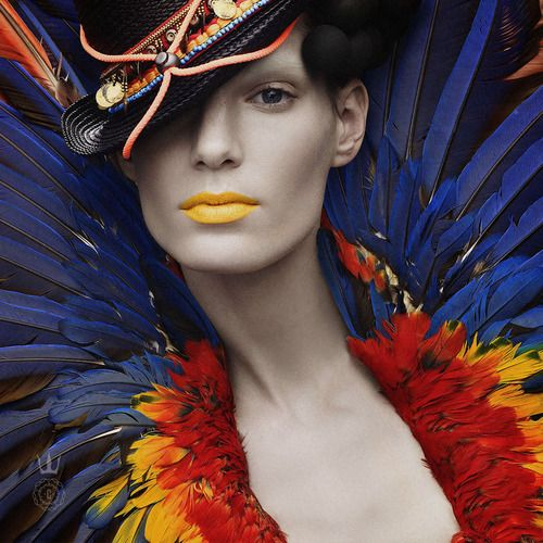 "Stefano-Moro by Capitol Couture Color at its finest! Choosing a kaleidoscopic ensemble radiates your natural confidence. A little birdie told us feathers are the upcoming ""it"" factor this summer- rock that plumage with Capitol pride."
