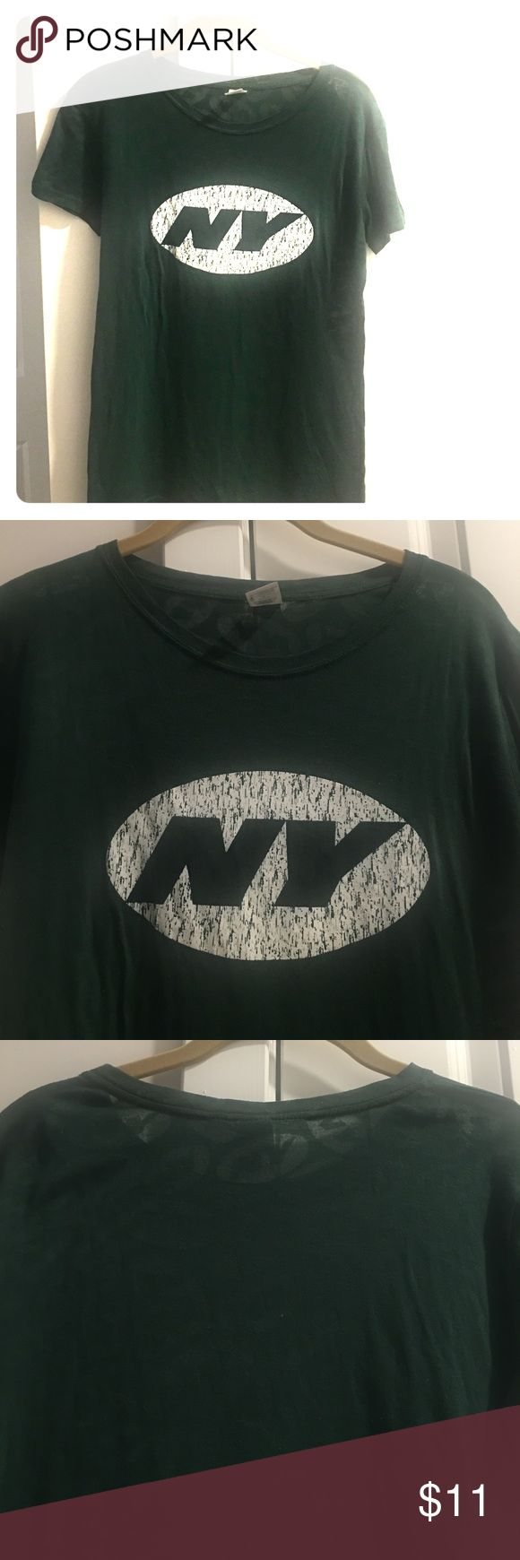🏈 Women's, NFL, Reebok, NY JETS Fitted T-shirt 🏈Women's, NFL, Reebok, NY JETS Fitted T-shirt. NY symbol embedded in a near see-through fabric. Unique t-shirt! 65% Polyester; 35% Cotton. Reebok Tops Tees - Short Sleeve