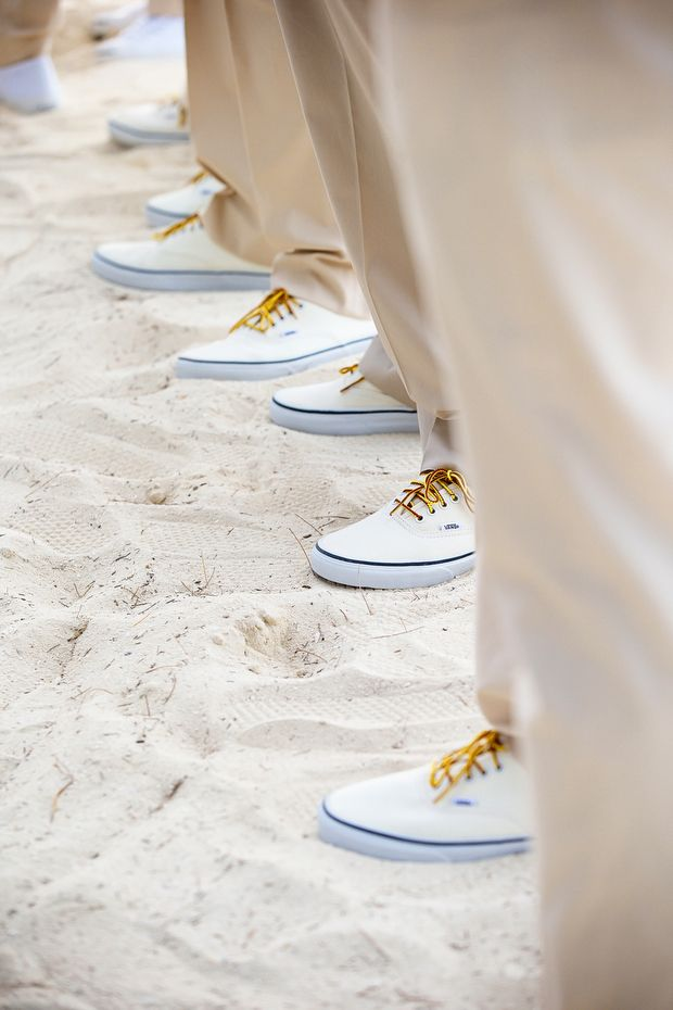 Maybe everybody's feet in the sand during formals. The boys will all have custom chuck taylors and I'd like a shot of girls feet too so might as well get everyone together in this foot shot somehow.
