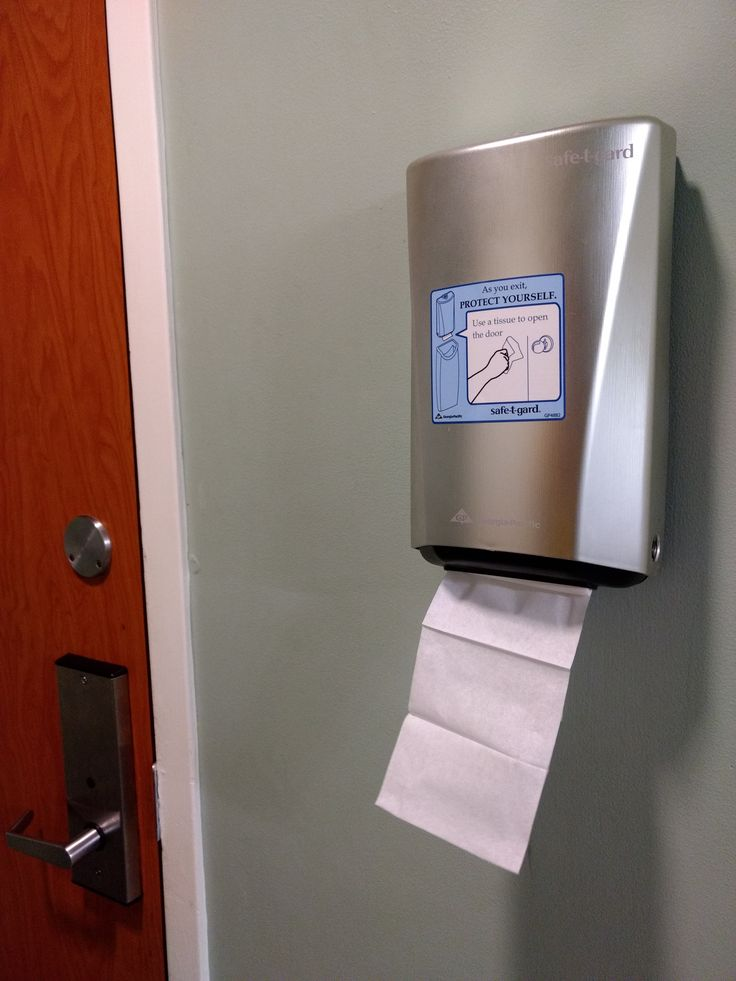 Protect Yourself! Use a tissue to open the door. An unusual place and purpose for a napkin. HCI wise, it makes you wonder: Are the protocols we have in place to guide users around the system and have been there for years, really the safest?