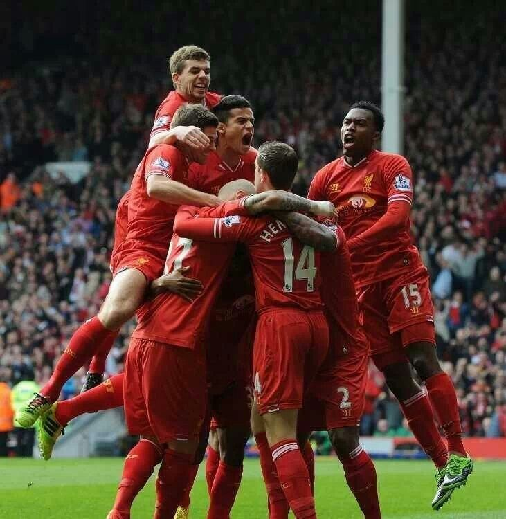 Liverpool players celebrate after scoring against Spurs. Could Luis Suarez break the goal scoring record?