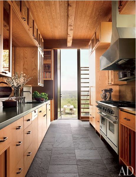 galley kitchen shape; lovely wood tones and slate floor