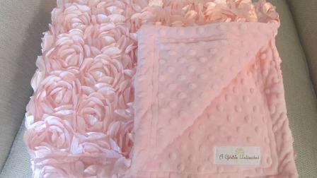 Pink satin rosette and pink minky dot baby blanket