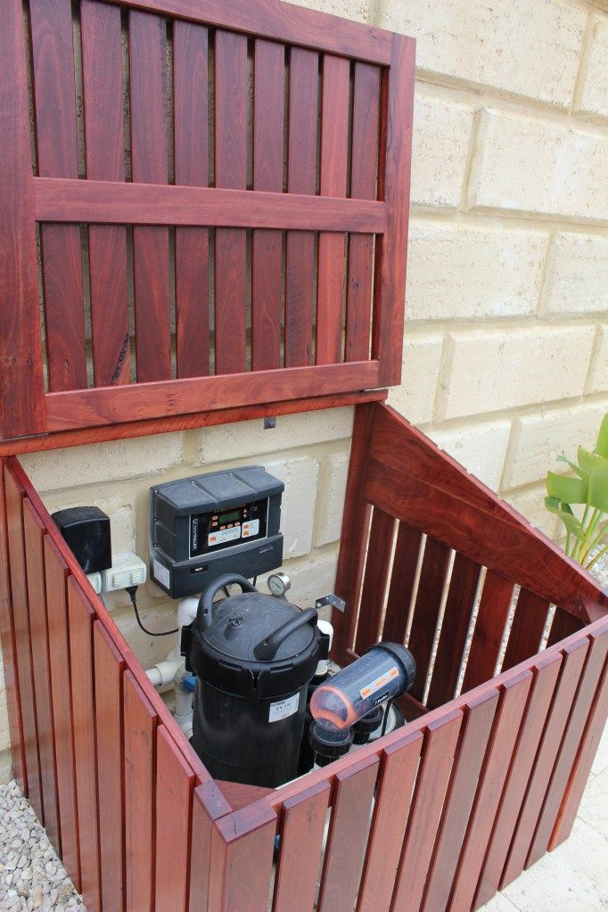 Hinged lid on pool pump enclosure ~ Instead of this kind of wood, use regular lumber or regular fence posts to match fence.