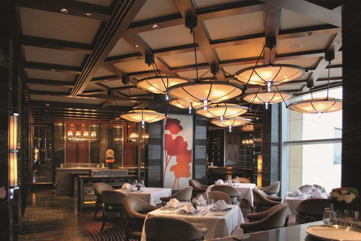 The elegant Vida Rica Bar & Restaurant in the Mandarin Oriental Hotel in Macau, gleams with elements of marble, chrome and crystal. We provided one of the most technically challenging chandeliers ever created under the guidance of interior designers from DESIGN STUDIO SPIN based in Japan. #light #lighting #design #designlighting #interior #chandelier #hospitality #hotel #restaurant