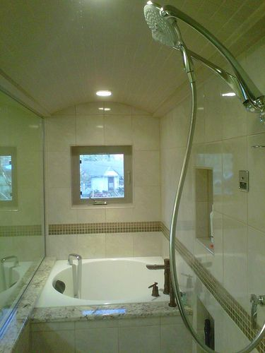 Image Of A small Japanese soaking tub is right at home in this beautiful steam shower