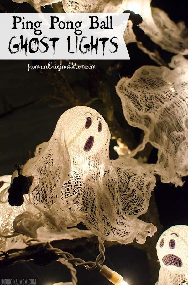 DIY Ping Pong Ball Ghost Lights displayed on a spooky Halloween tree - great front porch decor for trick or treat night!