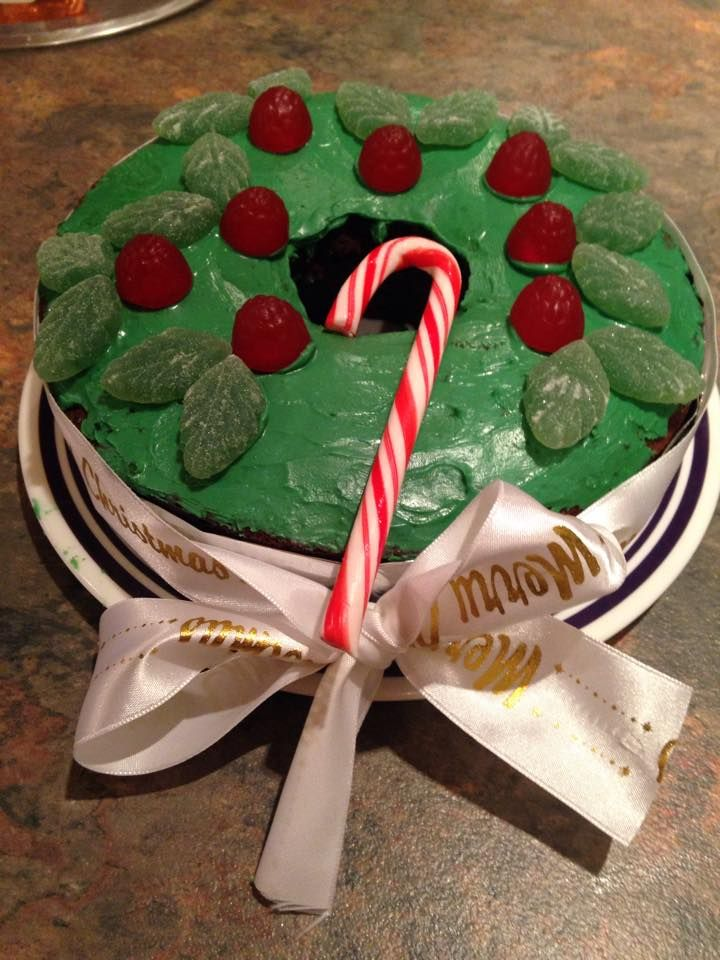 Christmas 'wreath' cake I made! Chocolate cake with green candy melts.. then used peppermint leaves and raspberry drops to decorate :)